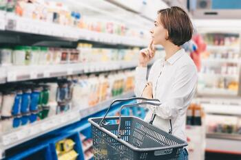 Person in grocery store looking at wellness items on shelf