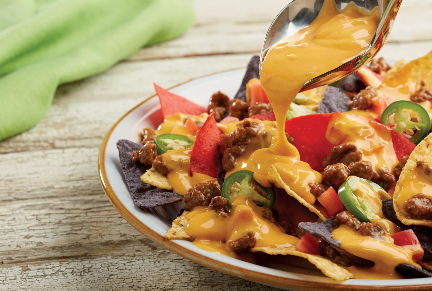 Nachos with creamy cheese sauce—see Grande Custom Ingredients at IFT 2017