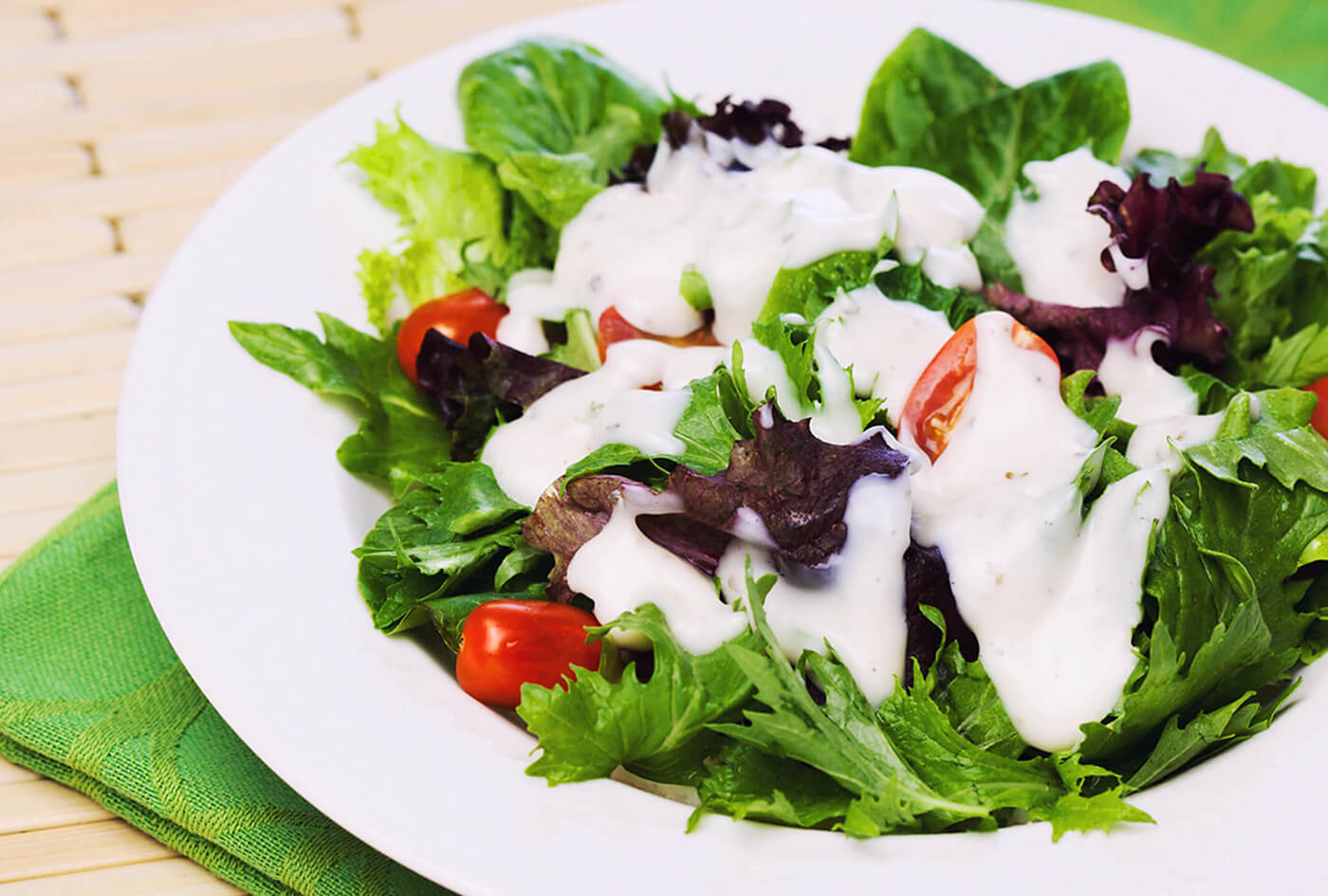 Mixed greens salad with cherry tomatoes and GCI improved dressing
