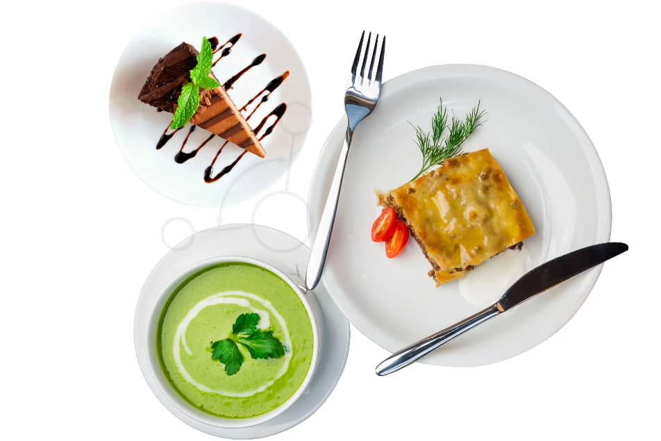 soup cake and lasagna on three small plates with knife and fork
