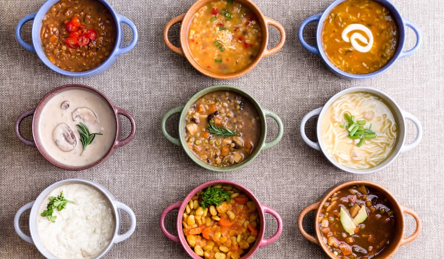 bowls with different types of soups reformulated with yogurt